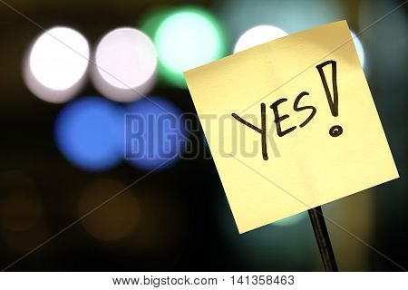 The concept of voting signboard with the word Yes! on abstract light background