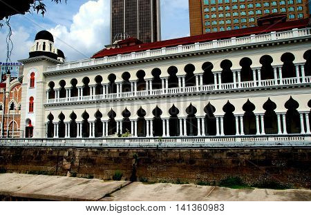 Kuala Lumpur Malaysia - January 4 2008: Double colonnades with neo-Moorish windows decorate the government's law courts building in Merdeka Square
