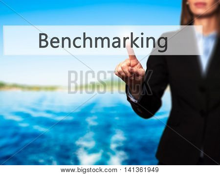 Benchmarking - Successful Businesswoman Making Use Of Innovative Technologies And Finger Pressing Bu