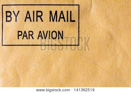 Black air mail stamp on yellow envelope