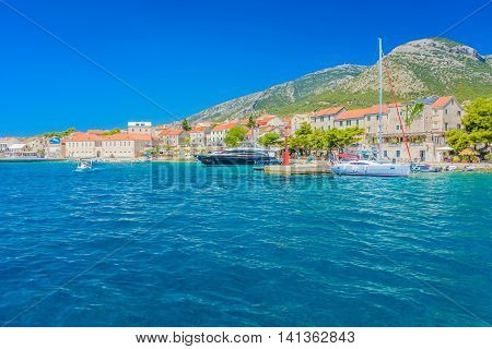 Waterfront cityscape view at town Bol, touristic destination on Island of Brac, Croatia summertime.