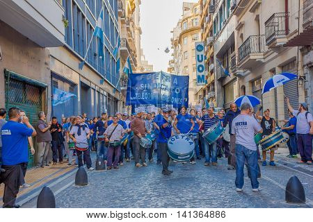 BUENOS AIRES, ARGENTINA - MAY 02, 2016: unidentified people singingd and playing drums in a protest against a public company.