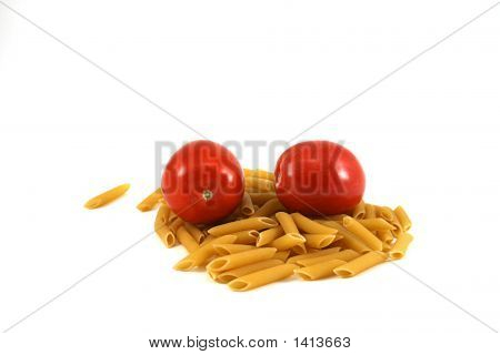 Uncooked Pasta And Tomato