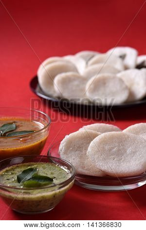 Idli With Sambar And Coconut Chutney On Red Background, Indian Dish : South Indian Favourite Food Ra