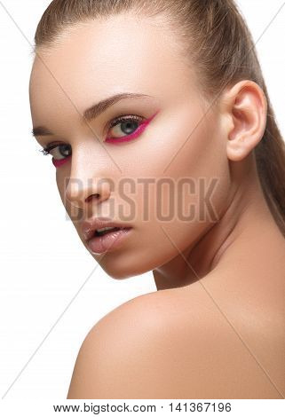 Glamour purple or magenta arrow makeup close with fashion red nails on face. Woman with perfect skin. Macro shot.