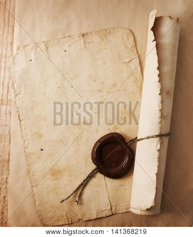Blank old paper with space for text, with a wax seal and feather