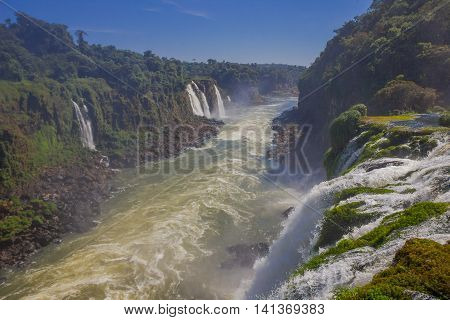 IGUAZU, BRAZIL - MAY 14, 2016: nice view of the river that flows collecting the water from some other little waterfalls.
