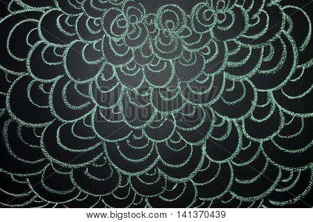 Сurls drawn with green chalk on a blackboard