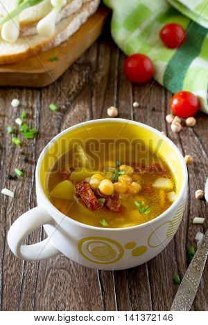 Vegetarian Vegetable Soup With Chickpeas, Potatoes And Sundried Tomatoes On A Wooden Table, A Health