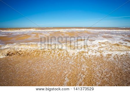 Beautiful seascape. Broken dirty water. Lumpy sea.