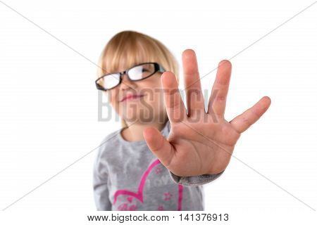 Portrait of a Young Girl Making Stop Gesture