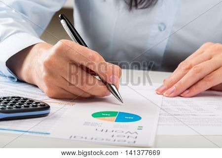 Close-up of a Businesswoman Analyzing Financial Figures