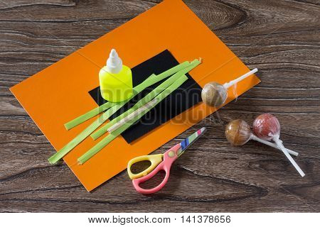 The Child Create A Greeting Packaging For Lollipop On Halloween Pumpkin Paper, Paper, Glue, Scissors
