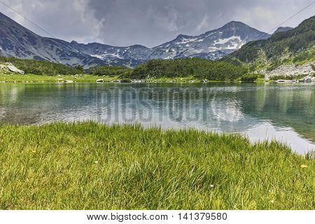 Panoramic view of Banderishki chukar peak and Reflection in Muratovo lake, Pirin Mountain, Bulgaria