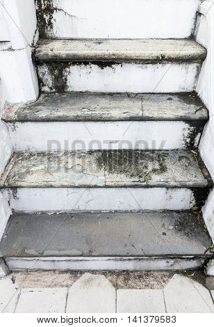 Old dirty staircase with the lichen stain of the way to the Thail temple.