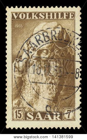 Germany, Saarland - CIRCA 1955: a stamp printed in the Saar, Germany shows painting by Albrecht Dürer, head of an old man, Albertina, Vienna, circa 1955
