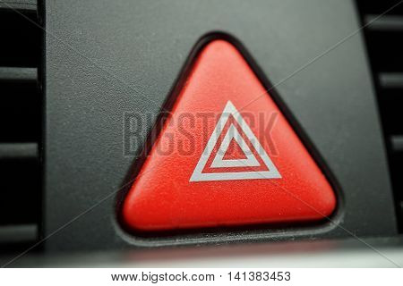 Red car Warning button with a white triangle switching all the vehicle outdoor indicators as a symbol of  caution, warning and potential danger