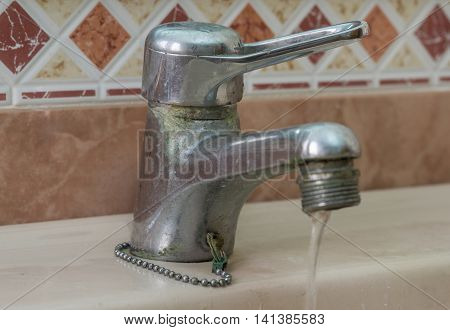 Water tap with limescale soiled bathroom Calcified faucet water flowing