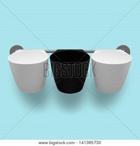 Capacities - Three empty white and black plastic cups on a light blue background.
