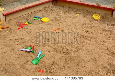children's sandpit with toys sand after the game kids