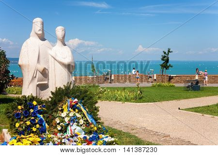 TIHANY HUNGARY - JULY 30 2016: Statue of King Andrew I and Anastasia next to the Benedictine Abbey in Tihany with Lake Balaton in the background