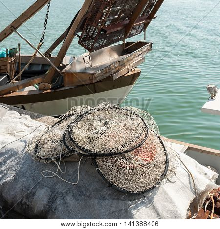 Pot made of nylon net with more rooms suitable for fishing in the lagoon to dry on the pier.