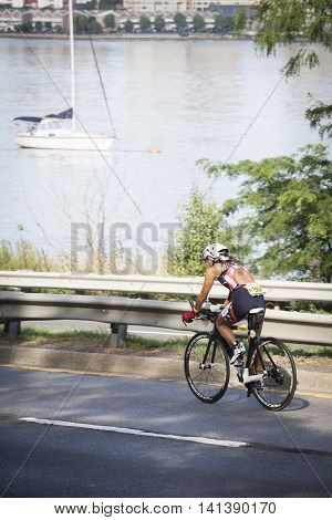NEW YORK JUL 24 2016: Athletes compete in the NYC Triathlon Race, biking 40 kilometers mainly on the Henry Hudson Parkway in New York on the only International Distance triathlon in New York City.