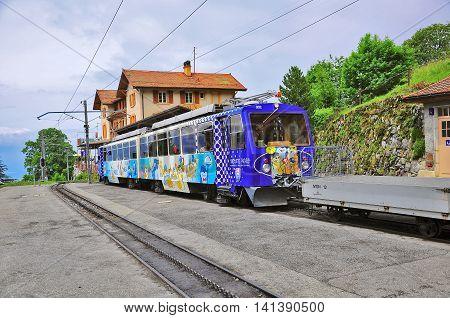 Caux Switzerland - June 15 2010: Passenger cogwheel train from Montreux to Haut-de-Caux stands by the platform.