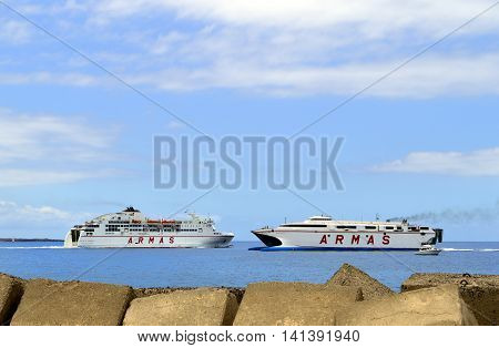 Los Cristianos harbour Tenerife Canary Islands Spain Europe - June 13 2016: ARMAS ferries passing each other in Los Crristianos harbour Tenerife