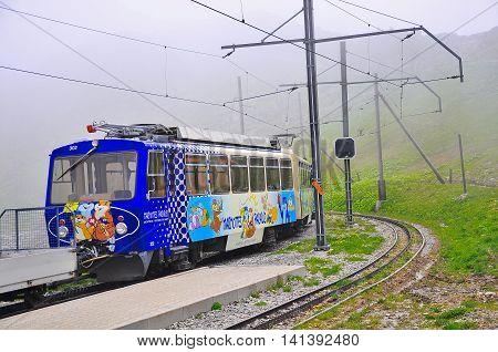 Haut-de-Caux Switzerland - June 15 2010: Passenger cogwheel train departs to Montreux.