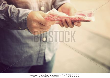 hands counting chinese cny cash on street