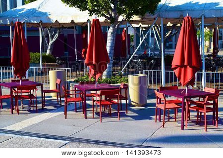 Outdoor furniture with tables and chairs taken in a courtyard garden