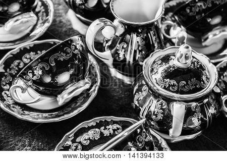 Blue Vintage tea set at a flea market in black and white