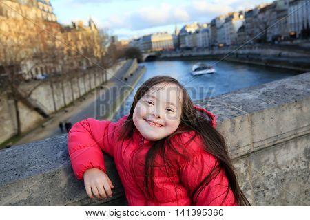 Portrait of little girl smiling in Paris