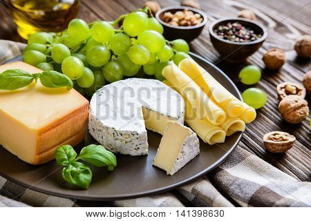 Assorted Cheese Plate With Fruit And Walnuts