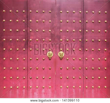 traditional chinese temple with guardian door knockers