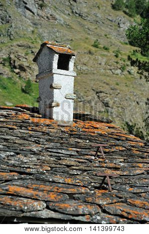 Alpine chimney and roof coatings stone in Rhemes Notre Dame
