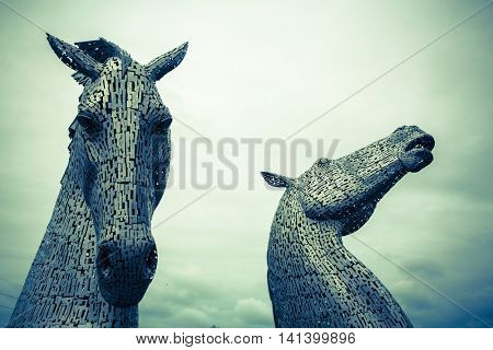 FALKIRK, SCOTLAND - 27 JULY 2015: The Kelpies, Scotland by sculptor Andy Scott. At 30 metres high, these are the biggest equine statues in the world. Cross-processed image.