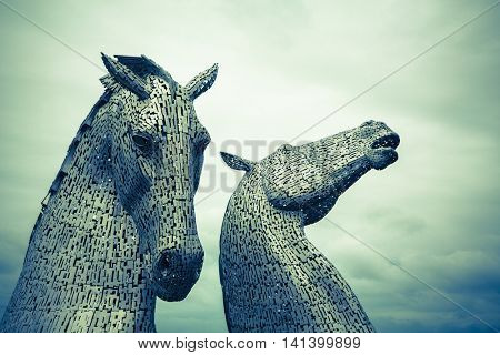 FALKIRK, SCOTLAND - 27 JULY 2015: The Kelpies, Scotland by sculpter Andy Scott. At 30 metres high, these are the biggest equine statues in the world.