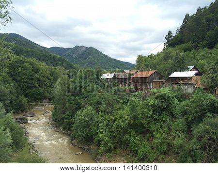 Romania, August 2015, Gura-Teghii,Buzau County, Moldova,  Mountain river is the border for multiple houses