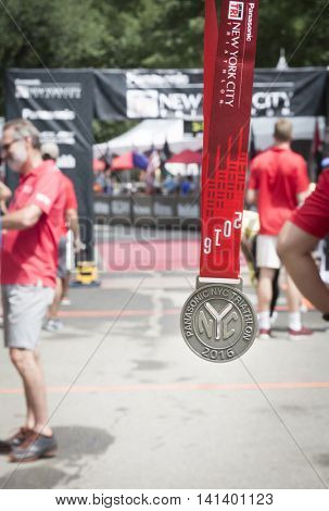 NEW YORK JUL 24 2016: The medal given for finishing the Panasonic NYC Triathlon Race. The course includes swim, bike, and run portions and is the only International Distance triathlon in the city.