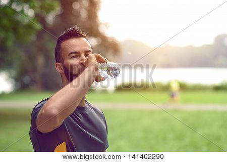 Young Man Drinking Bottled Water