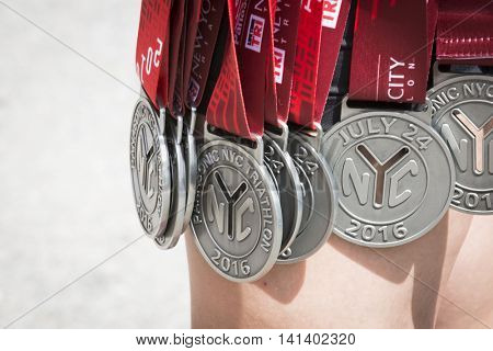NEW YORK JUL 24 2016: The medals given for finishing the Panasonic NYC Triathlon Race. The course includes swim, bike, and run portions and is the only International Distance triathlon in the city.