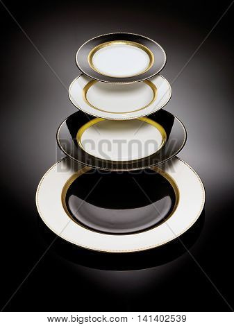 Black and white plates with gold rimmed