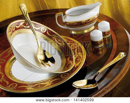 Porcelain dinner set on the table. Royal Gold Bordeaux
