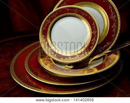 Porcelain plate set. Royal Gold Bordeaux on table