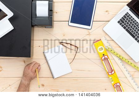 Man At Work On A Retail Carpenters Desk