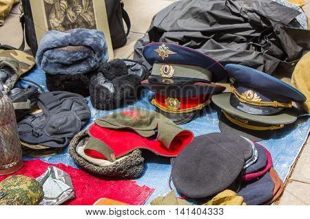 Old Soviet of hats employees at a flea market