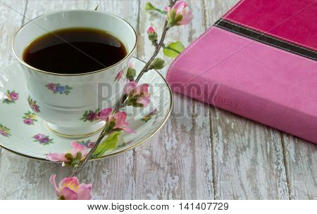 Woman's Bible With A Cup Of Coffee Or Tea