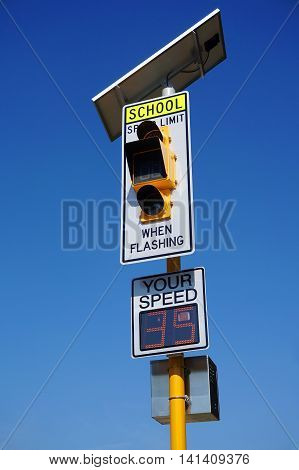 speed limit sign with speed detecting radar and solar panel